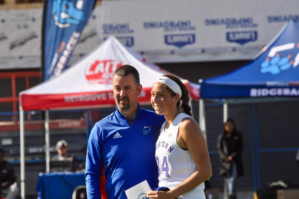 Fawn Porter standing with her coach.